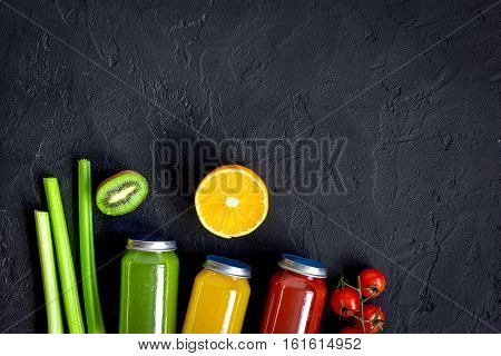 freshly squeezed juices for detox on dark background top view.