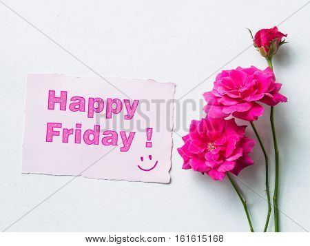 Top view of pink rose flower with happy Friday messege on paper note soft style