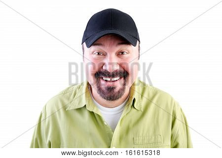 Head and shoulders portrait of grinning man in baseball cap white background