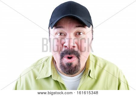 Head and shoulders portrait of excited man in baseball cap on white background