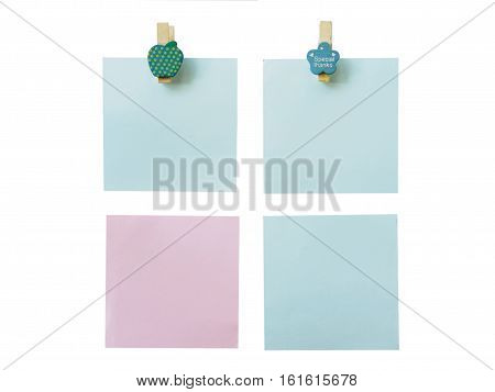 Collection of various paper note with wooden pinch of isolated on white background