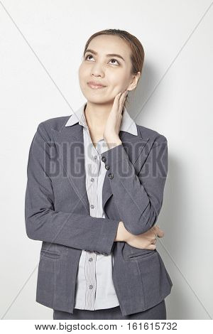 young businesswoman thinks about something,  worker, thoughtful, looking,