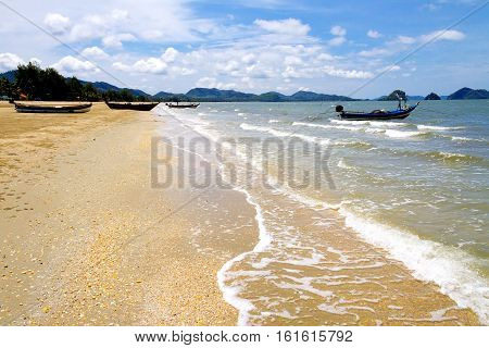 Small boat with wave and storm on seaside in Chumphon province Thailand.
