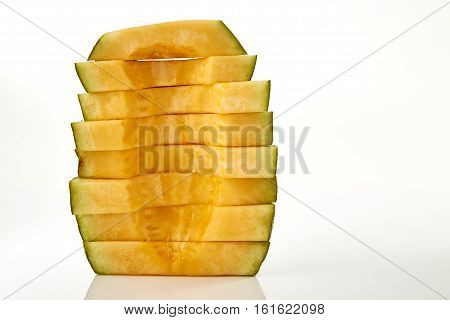 Hamigua Melon cut into slices Hami Melon Hami Cantaloupe isolated on white background. stack imag