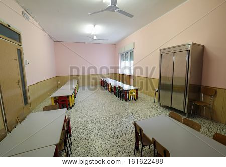 Classroom Nursery With Benches And Colorful Plastic Chairs