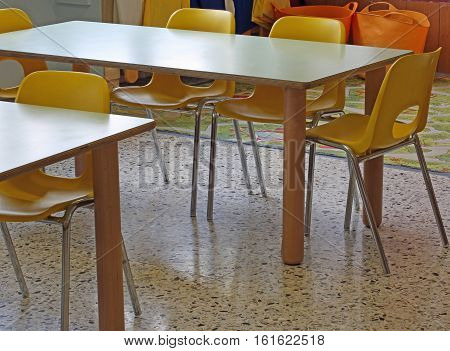Yellow Chairs And Small Tables Kindergarten School