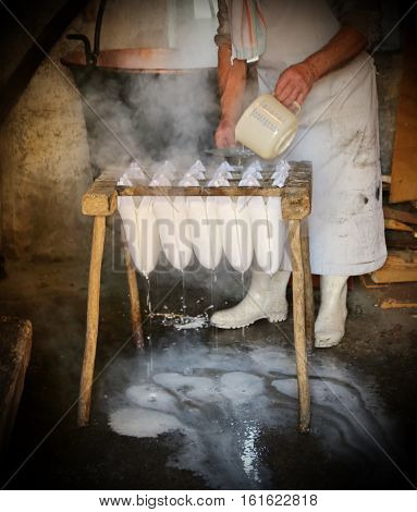 cheesemaker during the production of cheese in a mountain hut