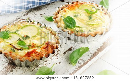 Tart With Cheese On White Wooden Table.