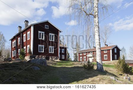 ALFTA, SWEDEN ON MAY 11. View of buildings belonging to Ol-Anders Homestead on May 11, 2013 in Alfta, Sweden. Old wooden, log building on a hill. Sunny evening. Editorial use.