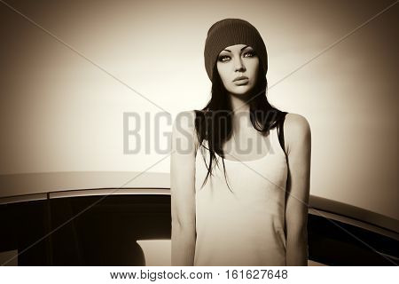 Young woman standing next to her car. Stylish fashion model outdoor