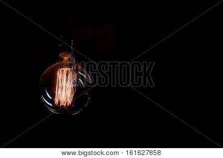 Vintage Incandescent Light Bulb Filament On Black, Close Up Shot
