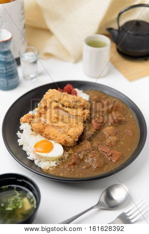 Japanese curry rice with fry pork TonkatsuKatsu Kare Japanese breaded deep fried pork cutlet.