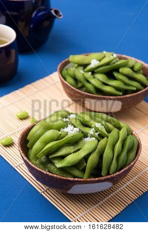 Edamame soy beans boiled green soy beans with tea set.