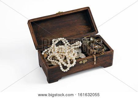 carved wooden casket with pearls and coins
