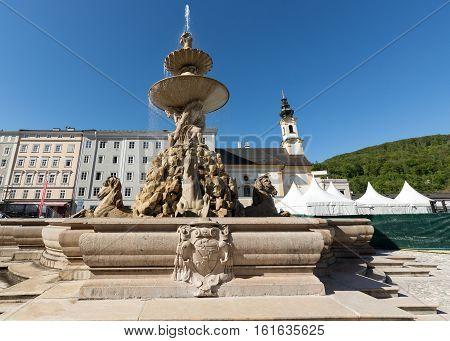 Baroque Residence fountain on Residentplatz in Salzburg. Austria