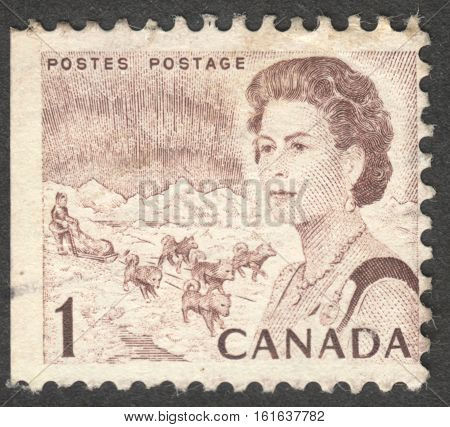 MOSCOW RUSSIA - CIRCA NOVEMBER 2016: a post stamp printed in CANADA shows a portrait of Queen Elizabeth II the series