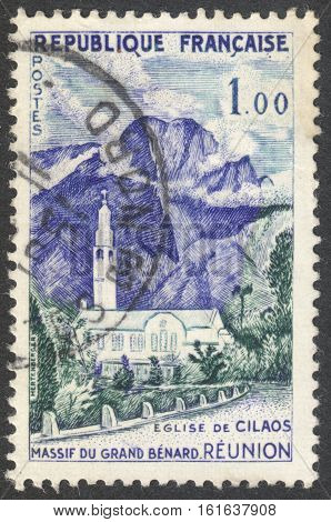 MOSCOW RUSSIA - CIRCA NOVEMBER 2016: a post stamp printed in FRANCE shows the Cilaos Church and Great Bernard Mountains Reunion the series