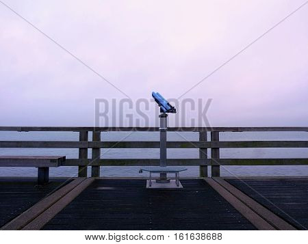 Abandoned Seaside Telescope At The End Of Pier. Autumn Misty Morning