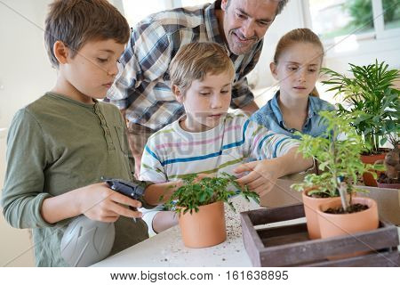Teacher with kids in biology class learning about plants