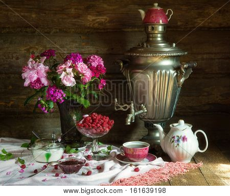 Tea Party in rustic style with samovar raspberry and jam
