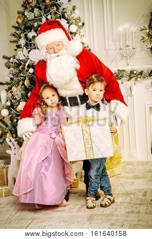 Santa Claus brought gifts for children. Christmas scene. Family celebration.