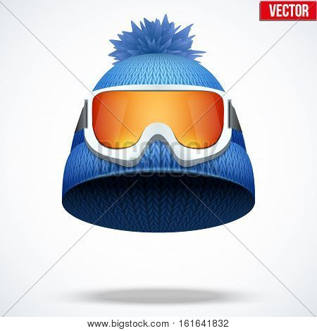 Knitted woolen cap with snow ski goggles. Winter seasonal sport hat. Vector illustration isolated on white background.