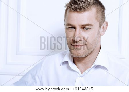Business concept. Men's beauty, fashion. Handsome mature man wearing classic white shirt.