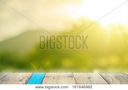 Blur Park With Nature Green Bokeh Sun Light On Copy Space Empty Old Wood Table Abstract Background.