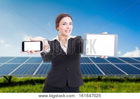 Young Business Woman Presenting Modern Smartphone And Tablet