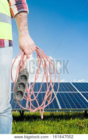 Unknown Engineer With Extension Cord In Hand