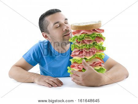 Adult man loves big sandwich isolated on white background.