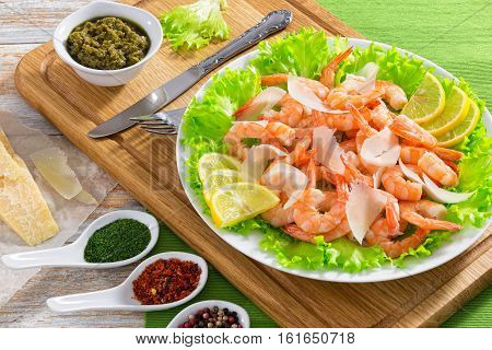 Salad With Prawns, Lettuce, Slices Of Parmesan Cheese And Lemon