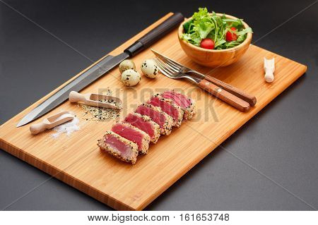 Grilled Tuna Fillet On A Wooden Board.