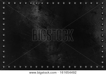 Black metal plate texture with rivet for background