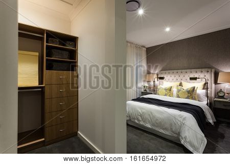 luxury bedroom and wooden cupboard area view at night with lights on