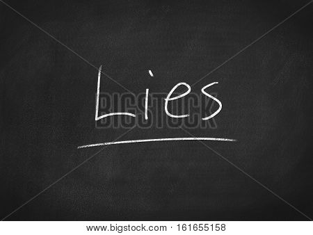 lies concept word text on blackboard background