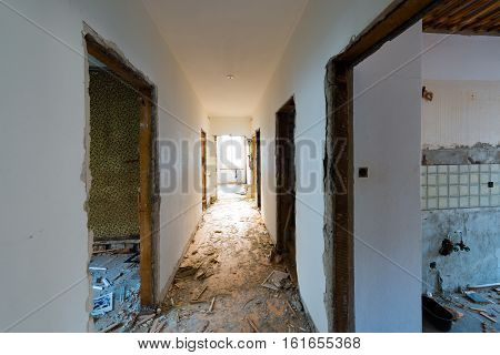 Old abandoned house. The room is destroyed the walls are broken trash on the floor chaos. Selective focus.