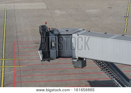 Airplane bridge footpath in the airport for passengers entering or leaving the plane.
