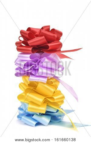 a stack of satin gift ribbon bows of different colors on a white background