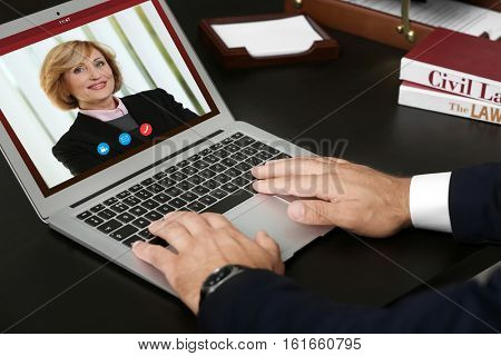 Woman video conferencing with lawyer on laptop. Video call and online service concept.