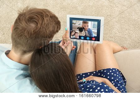 Video call and chat concept. Parents video conferencing on tablet