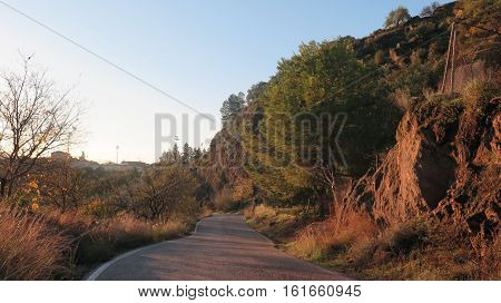 Hilly windy country lane in Alora countryside Andalusia