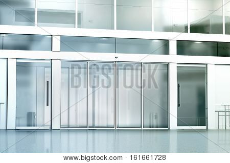 Blank commercial building glass entrance mockup 3d rendering. Business canter closed entry mock up. City bank exterior outdoor template. Corporation facade architecture front view.