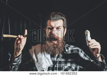 Bearded Man Shaves With Razor