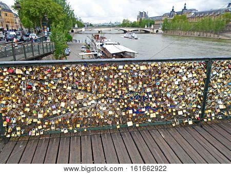 Love padlocks on the bridge Pont des Arts across river Seine in Paris, France
