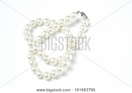 closeup White pearls collier on white background