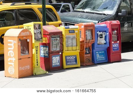 New-York City USA - May 4 2015: free newspaper dispensers in a street of Manhattan