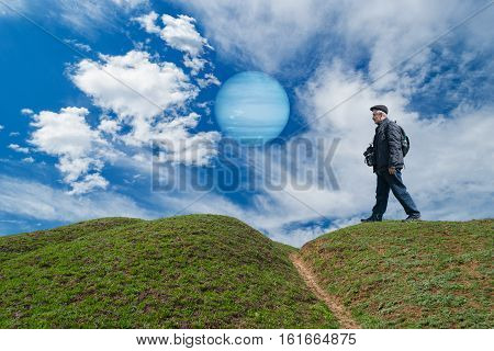 Brave tourist on a desolate planet walking in search of interesting photo locations.