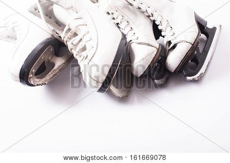 Two pairs of skates close up on the ice