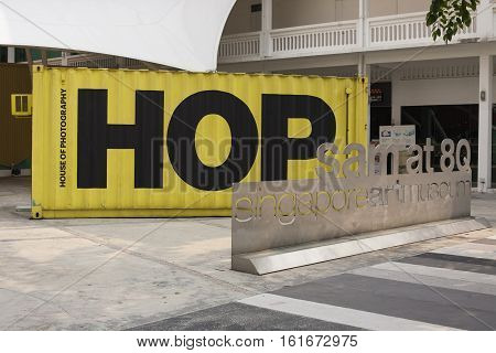 Singapore - 01 November 2014: art museum sam at 8Q house of photography with big yellow container, text HOP